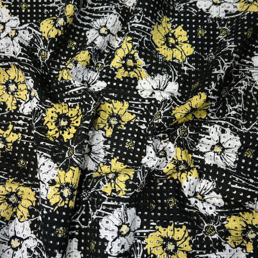 síto černo-žluté květy