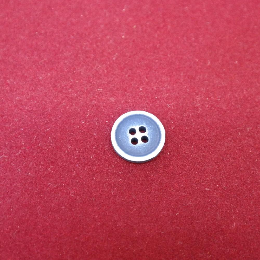 knoflík modrý