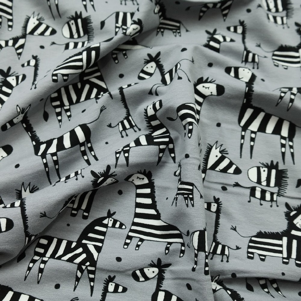 úplet šed. zebra