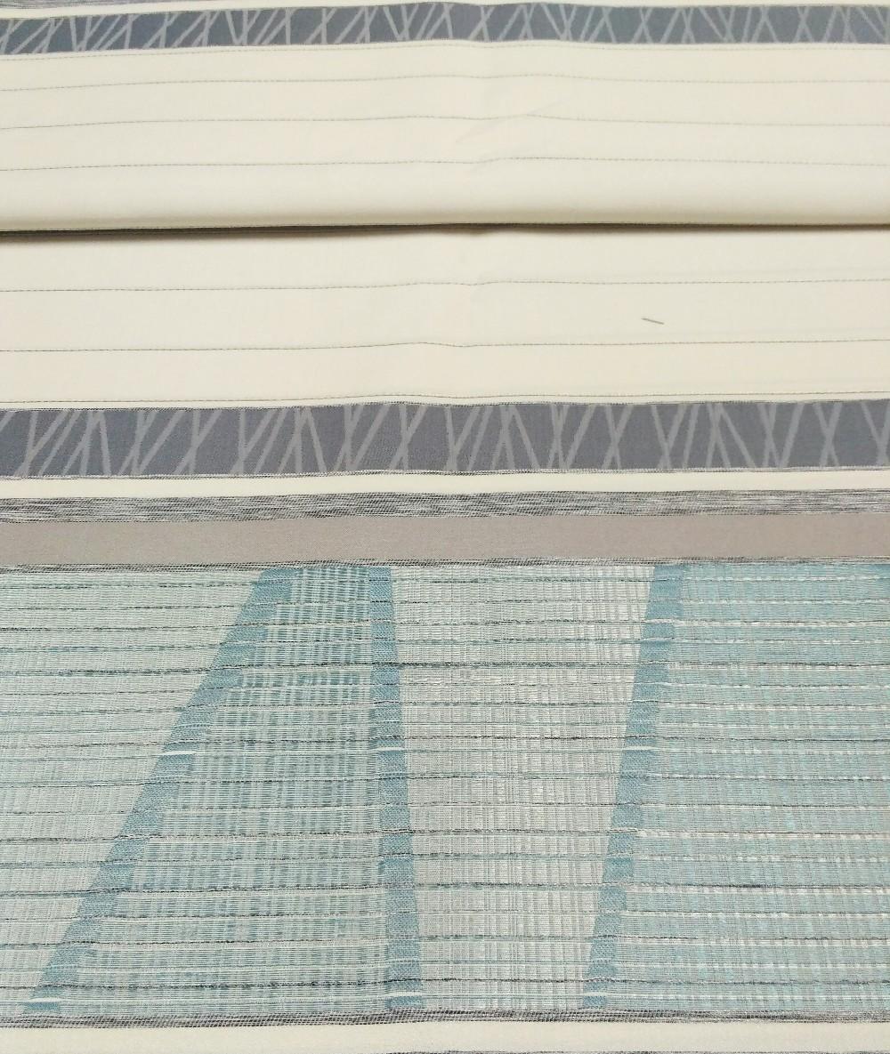 záclona Un 6483 smetanovošedopetrolejový pruh vzor š.140cm