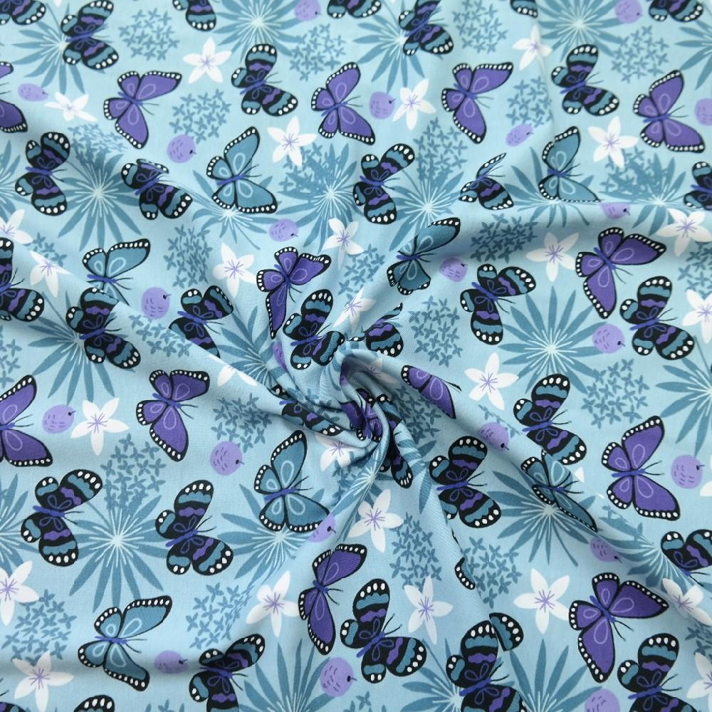 úplet modrý,motýli,bílý květ