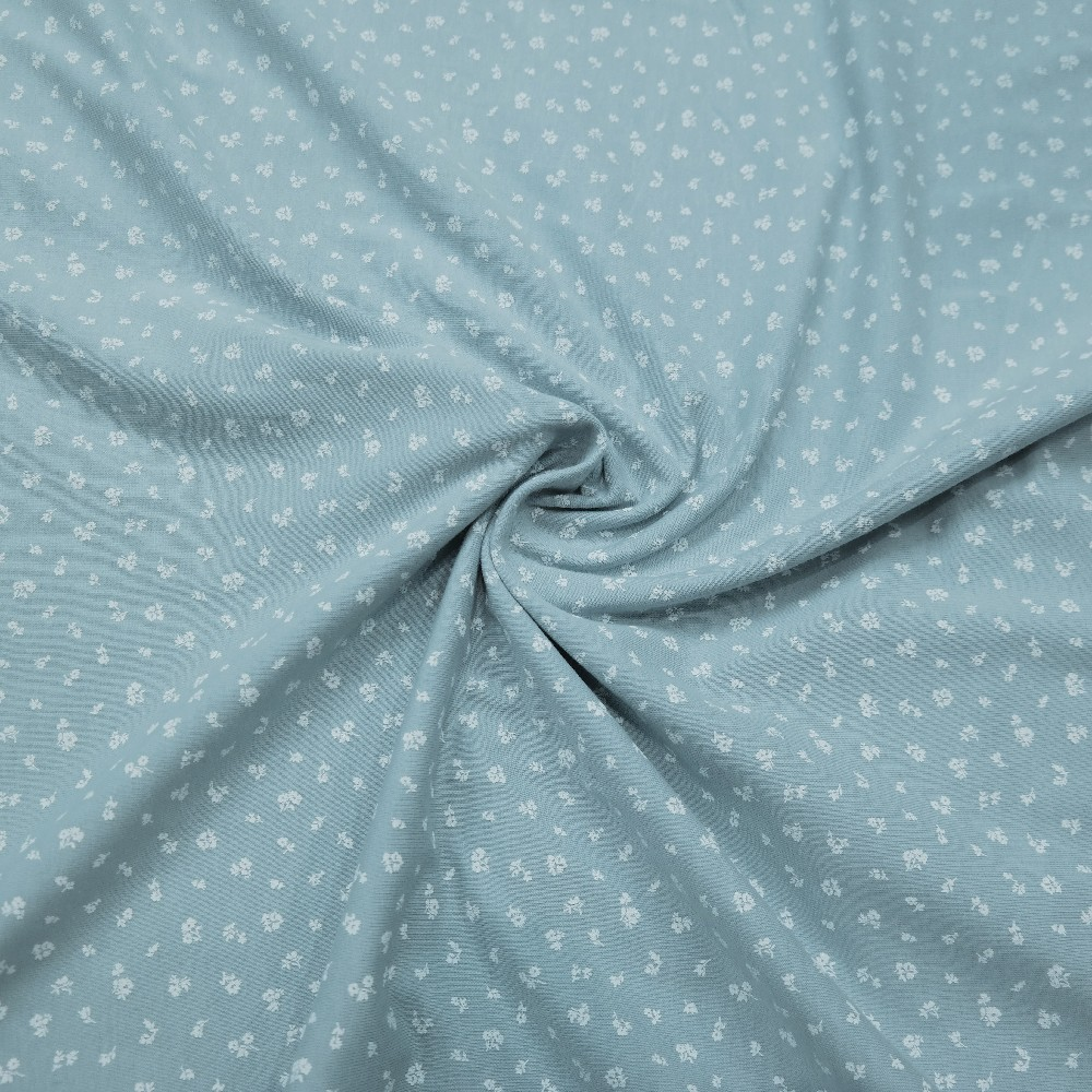 úplet sv.modrý,drobný bílý kvítek
