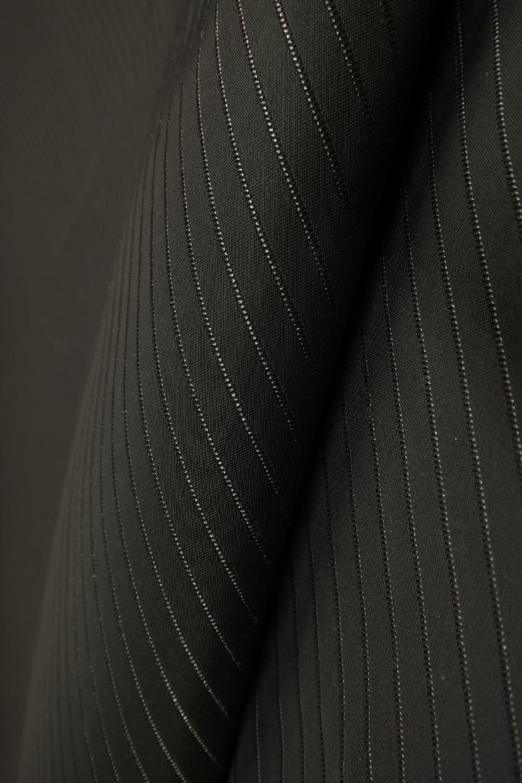 lamino černé s proužky