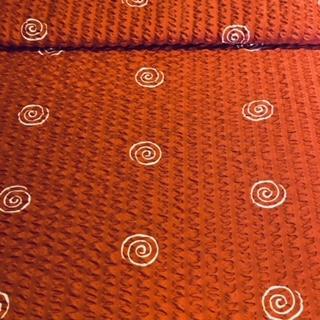 bavlna krep tm. oranž. ulitky