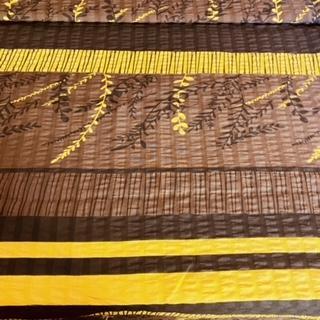 bavlna krep žlut.hnědé pruhy-květy š.143