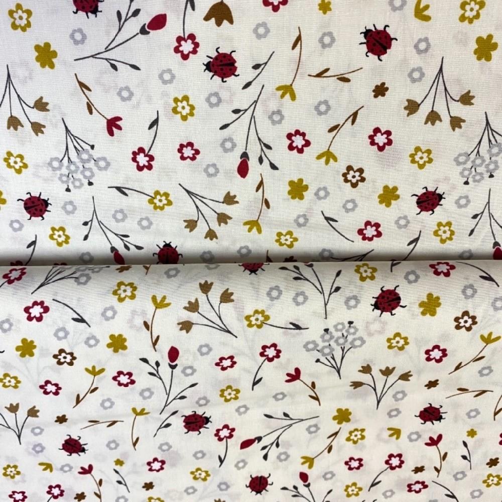 bavlna krémová berušky kytičky 140 cm