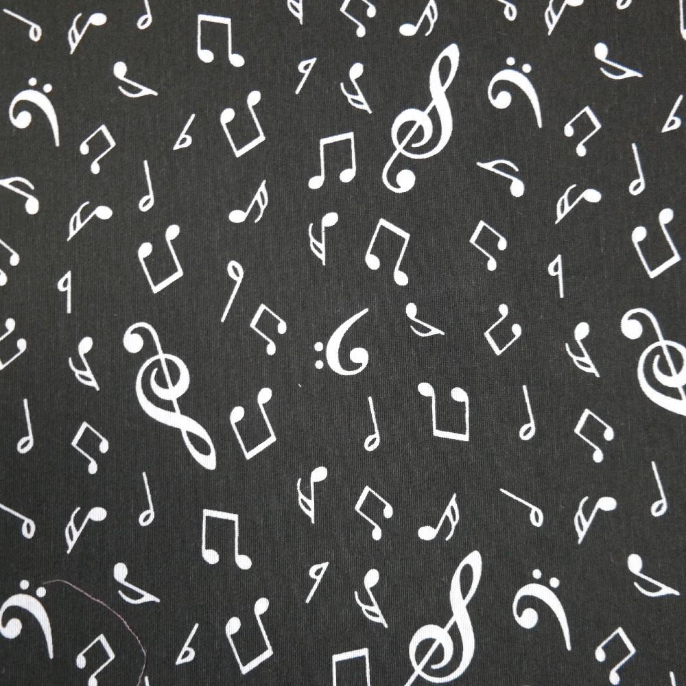 dekoračka LONETA  bílé noty na černém podkladě 140