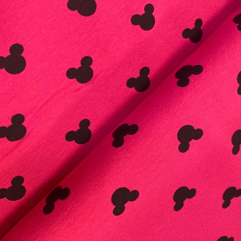teplákovina mickey mouse na růžovém podkladě