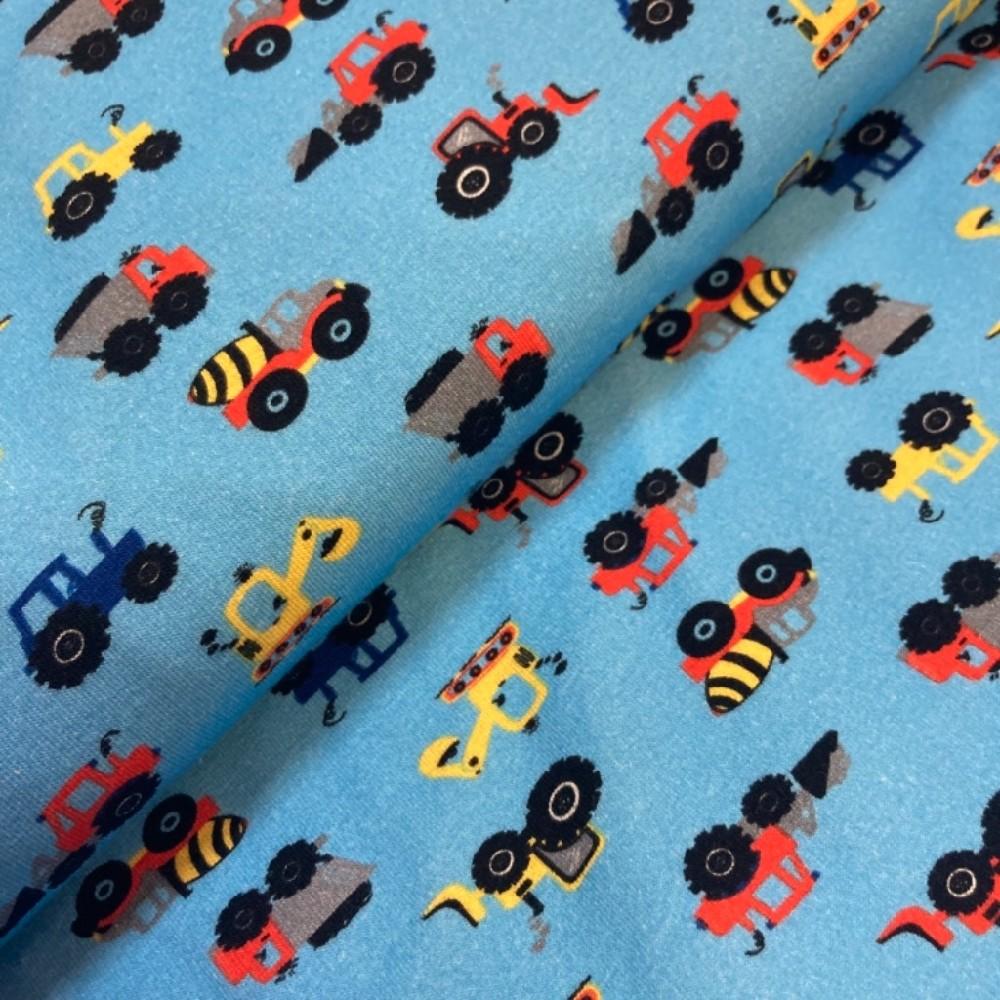 úplet traktory na modrém podkladě
